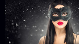 Beauty glamour brunette woman wearing carnival dark mask, party over holiday glowing black background - 236747119