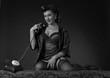 Leinwanddruck Bild - Beautiful woman in pin up style with perfect hair and make up speaking via vintage phone.