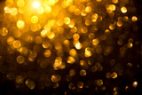 Christmas golden glowing background. Holiday abstract defocused backdrop. Tinsel blurred gold bokeh on black background - 236766119