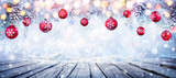 Christmas Table With Red Hanging Balls In Snowy Background