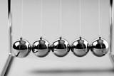 Newtons Cradle balancing balls, business concept in studio - 236775318