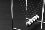 Newtons Cradle balancing balls, business concept in studio - 236775339