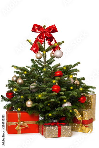 Foto Murales Christmas tree with a red bow and christmas gifts isolated on white background