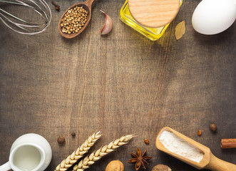 bakery ingredients on wooden background