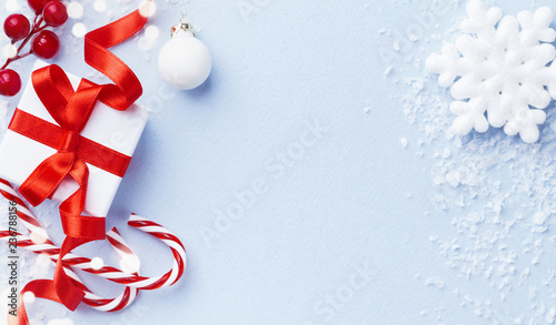Christmas card or banner. Christmas gift box and decorations on blue background.