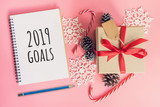 2019 New Year Goals, top view brown gift box, notebook and christmas decoration for new year on pink pastel color. - 236795905