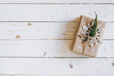 Brown gift box and Christmas presents on white wooden table background. - 236796140