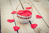Red heart in basket on wooden table for valentine day and love concept with copy space. - 236796924