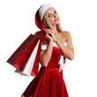 Leinwanddruck Bild - Girl in santa claus costume shopping