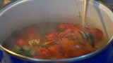 4K Checking with a spoon boiling crawfish  - 236809300