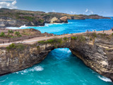 Rock coastline. Stone arch over the sea. Broken beach, Nusa Penida