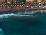 aerial view of people sunbathing at seaside in evening time