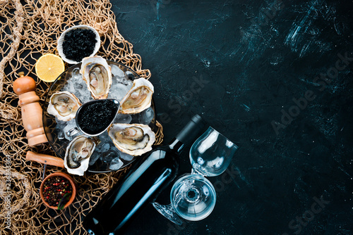 Fresh oysters with ice and red wine. Seafood. Top view. Free copy space. - 236843364
