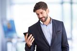 Businessman text messaging - 236843535