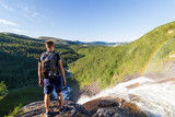 person enjoying the scenic landscape view, fjell, Mountains, waterfall