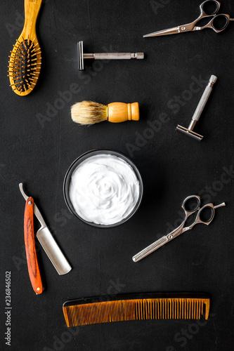 Leinwandbild Motiv barber workspace in barbershop with equipment dark background top view