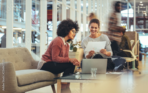 Foto Murales Women entrepreneurs sitting in a lounge at work place