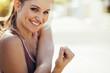 Leinwanddruck Bild - Smiling female athlete doing workout outdoors