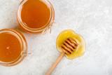 honey in jars on white table