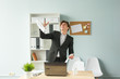 Business, humor and people concept - Handsome and young man in suit throws up sheets of paper in office