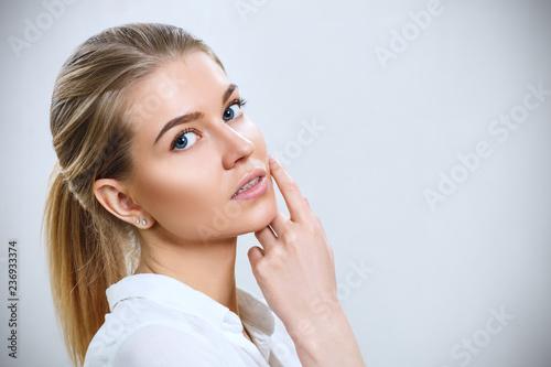 Leinwanddruck Bild Attractive caucasian woman with blond hair.