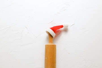 Christmas Baking background. Rolling pin on a white background