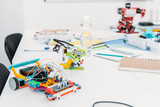 handmade robot models and school supplies on table in STEM classrom