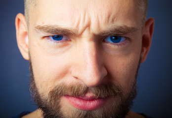 Portrait of a young man with a beard. Toned