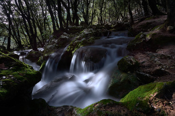 Natural waterfall of water in mediterranean forest. Spain. Balearic Islands