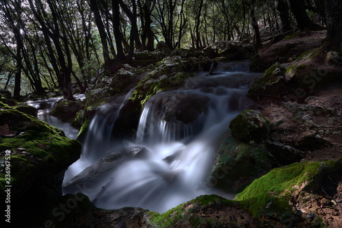 Natural waterfall of water in mediterranean forest. Spain. Balearic Islands - 236967532