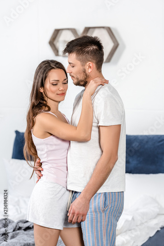43255a3b61 boyfriend and girlfriend in pajamas hugging in bedroom   Buy Photos ...