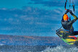 A male kiter jumps over a large lake. Close-up. - 236991715