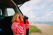 little girl looking through binoculars travel by car