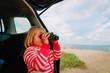 little girl looking through binoculars travel by car