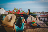 young woman having breakfast relax on scenic balcony terrace at sea - 236996777
