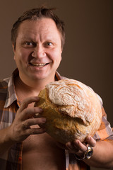 man and loaf of bread 3