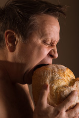 man and loaf of bread