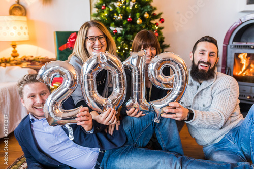 Happy people, friends celebrating new year 2019 - 237012117