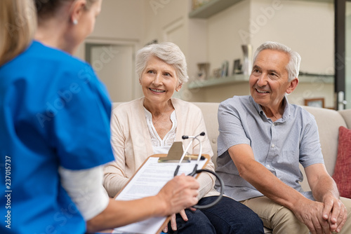 obraz lub plakat Senior couple consulting nurse