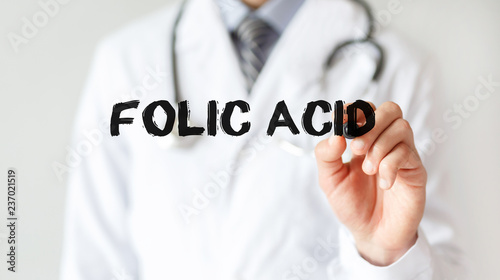 Doctor writing word Folic Acid with marker, Medical concept