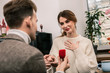 Leinwanddruck Bild - Woman feels happy while receiving a proposal