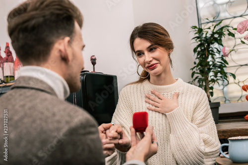 Leinwanddruck Bild Woman feels happy while receiving a proposal