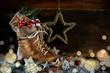 Leinwandbild Motiv Nikolaus -  Rustikaler Hintergrund mit Stiefel und Geschenk
