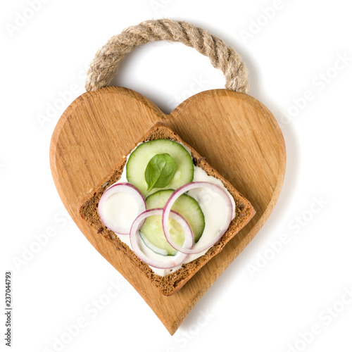 Leinwanddruck Bild Open  faced vegetable sandwich canape or crostini on a wooden serving board  isolated on white background closeup. Top view.  Vegetarian tartarine.