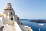 View of small chapel and cruise ship at santorini, greece