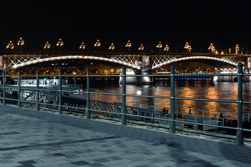 Night landscape in Budapest, view of the river, the bridge and the night lights of the city
