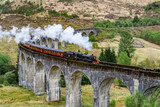 Glenfinnan Viaduct, Scotland. Travel/tourist destination in Europe. Old historical steam train riding on film scene famous viaduct bridge. Highlands, mountains, outdoor background. © Dajahof