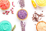Aromas of bath salt. Lemon, coffee, rosemary, rose, lavender near bowls with colorful bath salt on white background top view