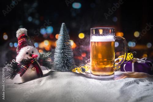Leinwandbild Motiv Christmas Beer on snow with decorative artwork