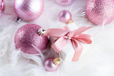 Pink Christmas decorations with gift box on white fur background close up - 237074196